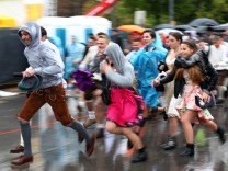 Visitors run to get a spot at the Oktoberfest area after the gates were open at the first day of the 184th Oktoberfest in Munich