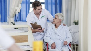 Nurse with elderly female patient in wheelchair model released Symbolfoto property released PUBLICAT