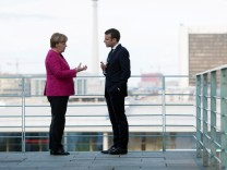 German Chancellor Angela Merkel and French President Emmanuel Macron meet at the Chancellery in Berlin