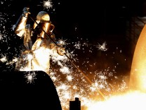 FILE PHOTO: File photo of worker of German steelmaker ThyssenKrupp controling a blast furnace in Duisburg