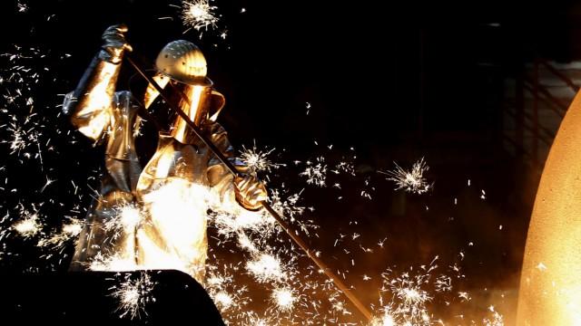 FILE PHOTO: File photo of worker of German steelmaker ThyssenKrupp controling a blast furnace in Duisburg