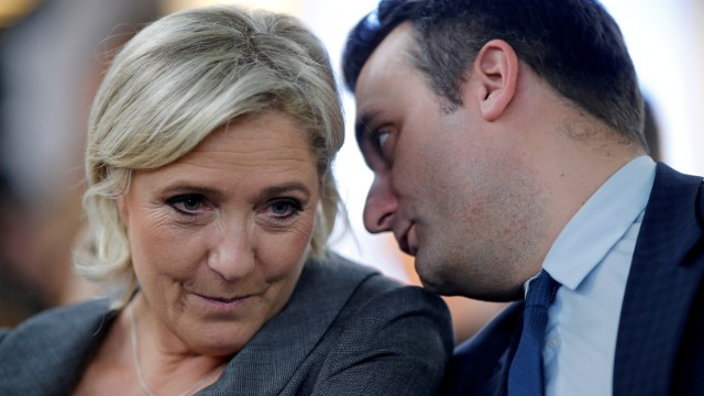 FILE PHOTO - France's far-right National Front (FN) leader Marine Le Pen and vice-president Florian Philippot attend a FN political debate in Paris