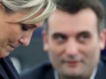 FILE PHOTO - French National Front (FN) political party leader Le Pen, and fellow MEP and FN vice-president Philippot attend the election of the new President of the European Parliament in Strasbourg