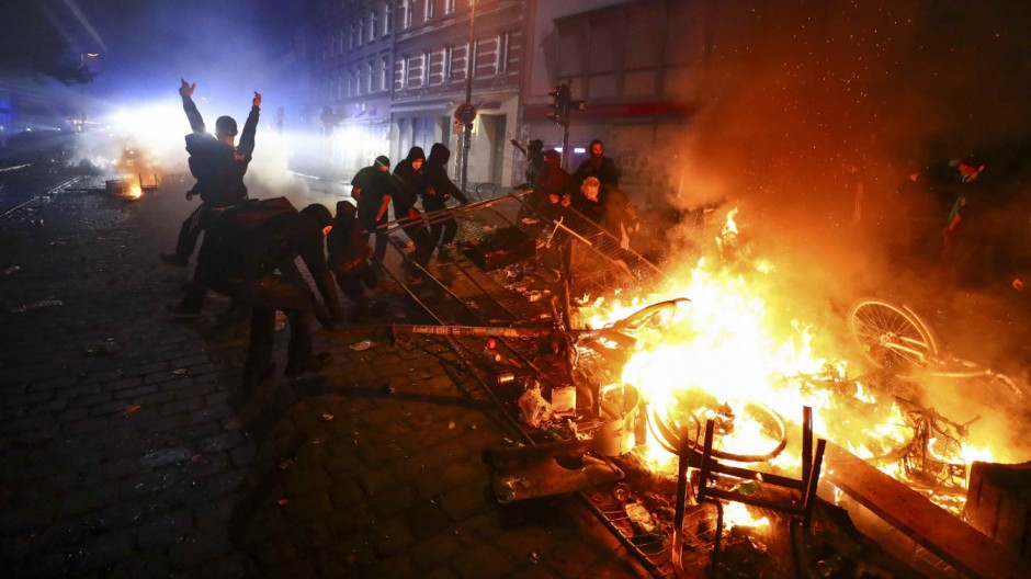 Barricades burn as protesters clash with riot police during the protests at the G20 summit in Hamburg