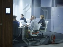 People hold a meeting in a room at the Jellyfish office space in London