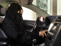 FILE PHOTO: A woman drives a car in Saudi Arabia