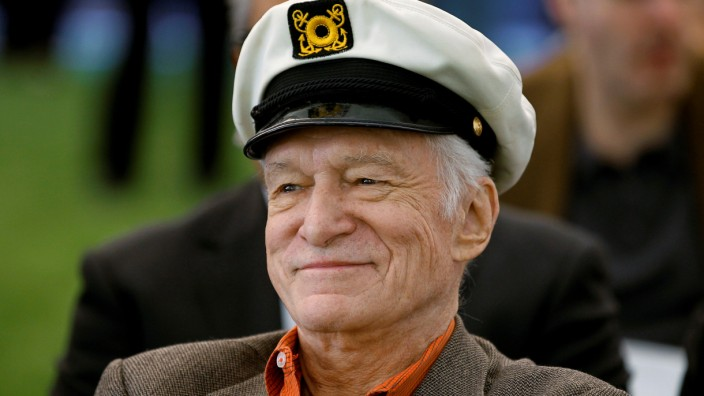 FILE PHOTO -  Playboy Magazine founder Hefner smiles at the news conference for the upcoming Playboy Jazz Festival, at the Playboy Mansion in Los Angeles