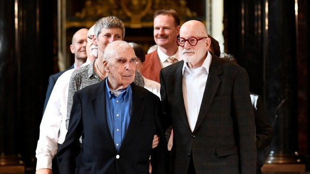 Alfred Kaine and his husband John Guenther lead a row of 14 same-sex couples after getting married during a media call at the town hall after the German parliament approved marriage equality in a historic vote this summer