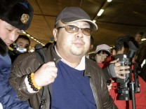 FILE PHOTO - Kim Jong Nam arrives at Beijing airport in Beijing, China, in this photo taken by Kyodo