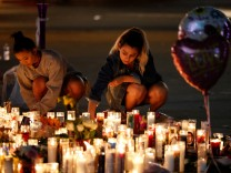 Women light candles at a vigil on the Las Vegas strip following a mass shooting at the Route 91 Harvest Country Music Festival in Las Vegas