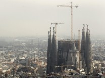 The Basilica Sagrada Familia is seen as fog gradually recedes in Barcelona