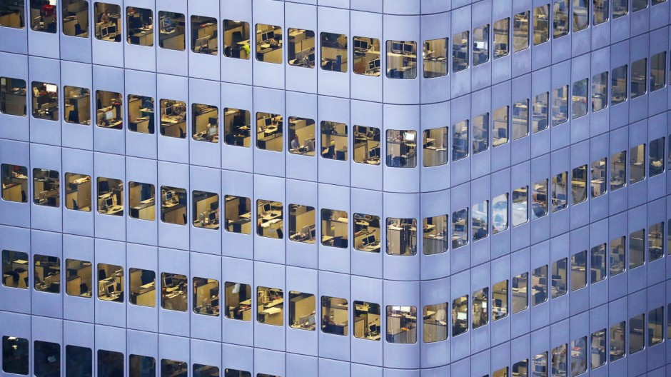 An office building is photographed from a tourist platform early evening in Frankfurt