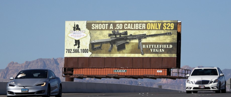 A sign advertising a gun range is seen near the Las Vegas Strip, two days after the Route 91 music festival mass shooting near the Mandalay Bay Resort and Casino, in Las Vegas