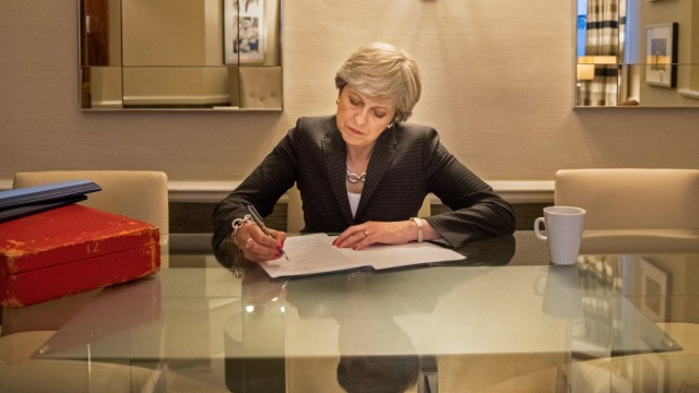 British Prime Minister Theresa May prepares her keynote speech ahead of the final day of conference, in Manchester