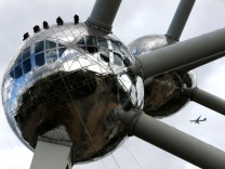Workers rappel down along a sphere of the Brussels' iconic monument Atomium during its annual cleaning
