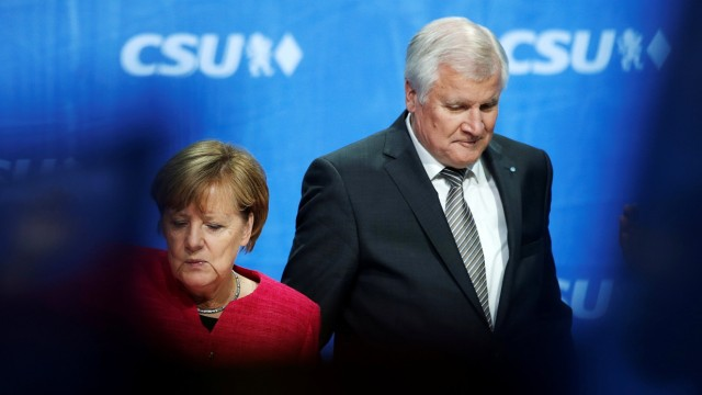 German Chancellor Merkel, top candidate of CDU for upcoming general elections and Seehofer head of CSU leave final election rally in Munich