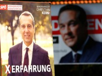 Election campaign posters of Social Democratic Party and Freedom Party are seen in Vienna