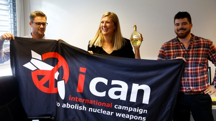 Fihn, Executive Director of ICAN, her husband Will Fihm Ramsay and Daniel Hogsta, coordinator, celebrate after ICAN won the Nobel Peace Prize 2017, in Geneva