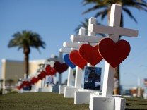 Some of the 58 white crosses set up for the victims of the Route 91 music festival mass shooting are pictured in Las Vegas