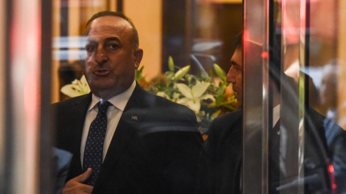Turkey's Minister of Foreign Affairs Mevlut Cavusoglu departs a meeting to discuss the Rohingya situation during the United Nations General Assembly in New York City