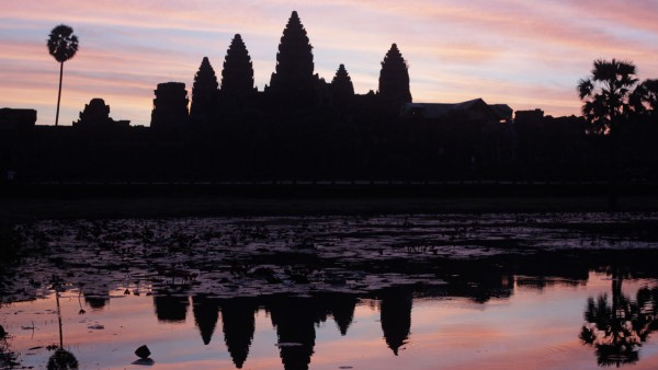 Cambodia's famous Angkor Wat temple is reflected in a pond during sunrise in Siem Reap; WIR
