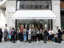 August 25 2017 London London UK Customers queue outside for the opening of H&M groups first A