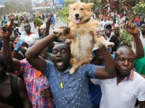 Supporters of Kenyan opposition National Super Alliance (NASA) coalition, hold up a dog during a demonstration in Nairobi