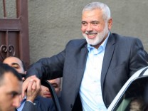 Hamas s overall leader Ismail Haniya arrives for a meeting with Palestinian Prime Minister Rami Hamd
