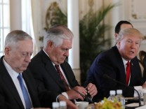 U.S. President Trump  sits with members of his cabinet during bilateral meeting with China's President Xi at Trump's Mar-a-Lago estate in Palm Beach