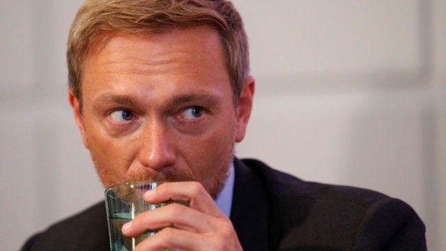 Germany's FDP leader Lindner listens during a news conference in Vienna