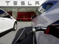 A Tesla Model X vehicle is charged outside a Tesla electric car dealership in Sydney