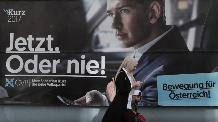 Election campaign posters of the OeVP and the SPOe are seen in Vienna