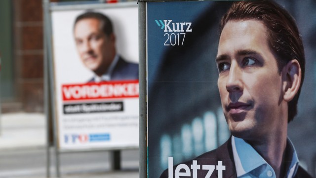 Election campaign posters of People's Party and Freedom Party are seen in Vienna