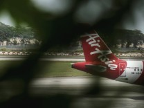 The Airbus A320 of AirAsia lowcost carrier seen through the glass a plant at Changi International Ai