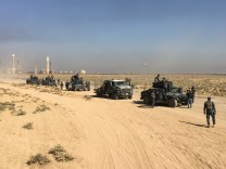 Members of Iraqi federal forces enter oil fields in Kirkuk, Iraq