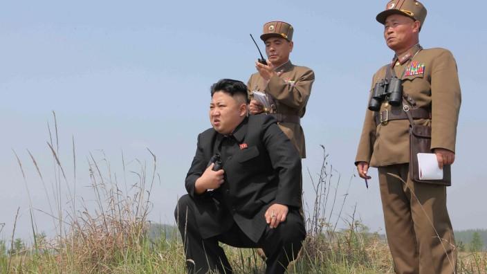 FILE PHOTO: North Korean leader Kim Jong Un guides the multiple-rocket launching drill of women's sub-units under KPA Unit 851