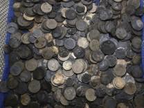Fast 1000 Münzen im Bauch einer  Schildkröte