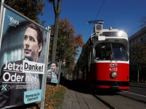 A sticker reading 'Thank you!' is seen on an election campaign poster with Kurz of the OeVP as a tramway passes in Vienna
