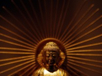 A pure gold statue of Buddha is displayed at the Ginza Tanaka store in Tokyo