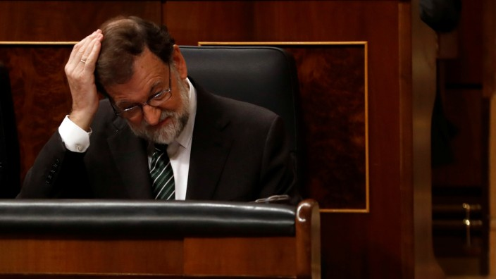 Spanish Prime Minister Mariano Rajoy gestures during a parliamentary session in Madrid