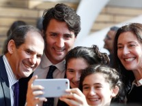 Children take a 'selfie' with Canada's PM Trudeau and Toronto Waterfront CEO Fleissig, during a press conference where Alphabet Inc, the owner of Google, announced the project 'Sidewalk Toronto' in Toronto