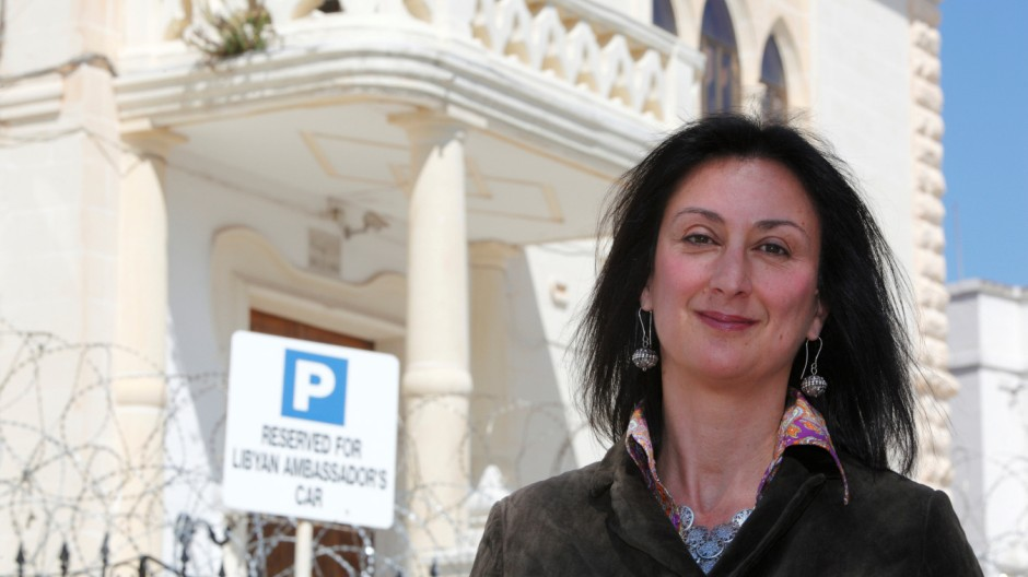 Maltese investigative journalist Daphne Caruana Galizia poses outside the Libyan Embassy in Valletta