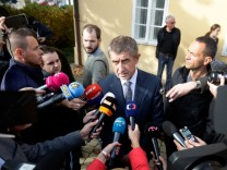 The leader of ANO party Andrej Babis speaks to media after casting his vote in parliamentary elections in Prague