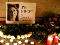 Candles burn to commemorate the killed investigative journalist Daphne Caruana Galizia in Berlin