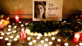 Candles burn to commemorate the killed investigative journalist Daphne Caruana Galizia in Berlin