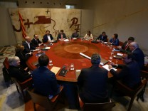 Catalan President Puigdemont presides over a cabinet meeting at Generalitat Palace in Barcelona
