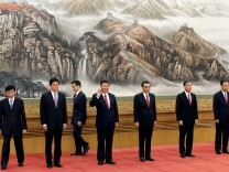 China's President Xi Jinping and other new Politburo Standing Committee members, Wang Huning, Li Zhanshu, Han Zheng, Li Keqiang, Wang Yang and Zhao Leji attend a meeting with the media at the Great Hall of the People in Beijing