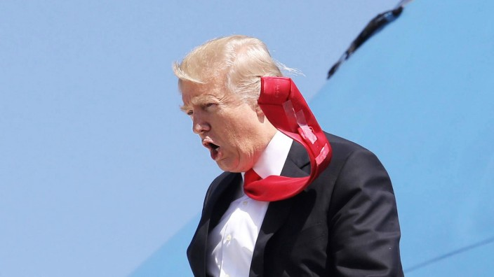 March 3 2017 Orlando Florida U S A strong wind blows President DONALD TRUMP S tie as he arri
