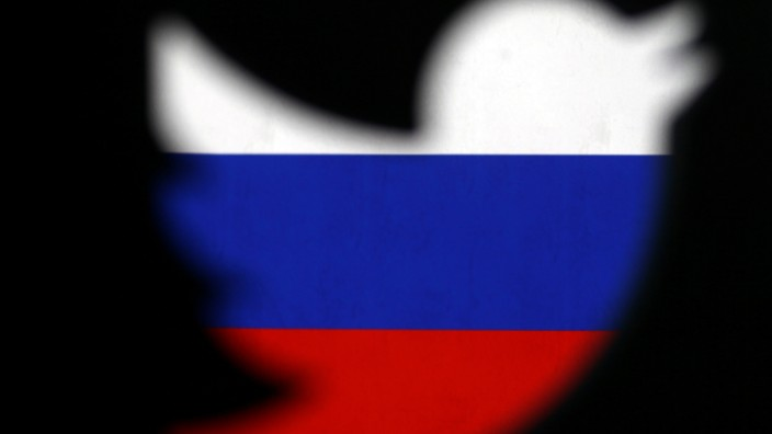 A 3D-printed Twitter logo displayed in front of Russian flag is seen in this illustration picture