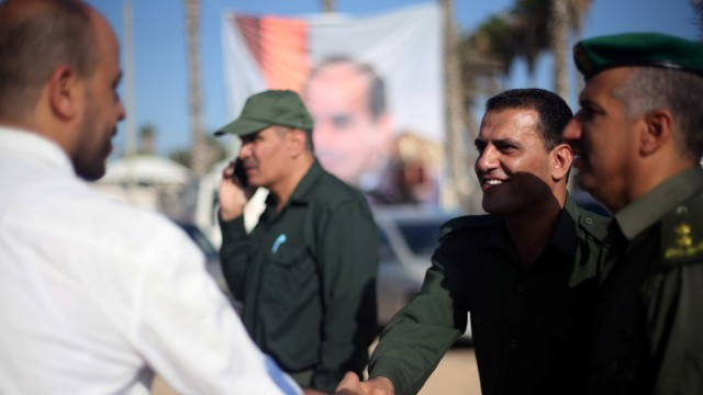 A member of the Palestinian security forces is greeted at Rafah border crossing with Egypt, in the southern Gaza Strip